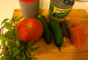 top left to right: tamarind paste, canned pineapple, basil, tomato, cucumber and salmon